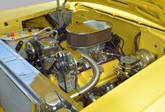 Customized car engine. In yellow motor car Royalty Free Stock Image