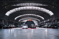 Customized cars parked in hangar Stock Photos
