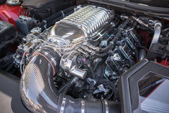 Customized muscle car engine displayed. Pomona, USA - March 12, 2016: Customized muscle car engine displayed during 3rd Annual Street Machine and Muscle Car Royalty Free Stock Image
