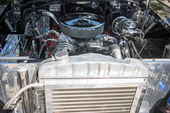 Customized muscle car engine displayed. Pomona, USA - March 12, 2016: Customized muscle car engine displayed during 3rd Annual Street Machine and Muscle Car Stock Photo