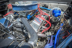 Customized muscle car engine displayed Stock Images