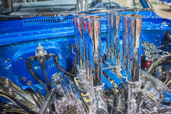 Customized muscle car engine displayed. Pomona, USA - March 12, 2016: Customized muscle car engine displayed during 3rd Annual Street Machine and Muscle Car Royalty Free Stock Photo
