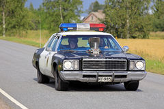 Customized Plymouth Police Car on the Road royalty free stock images