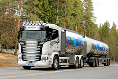 Customized Scania Milk Tank Truck on the Road. SOMERO, FINLAND - APRIL 9, 2017: Beautifully customized Scania milk tank truck of KM Kuljetus Oy transports Valio stock image