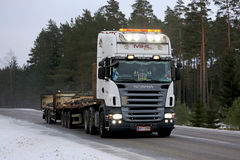 Customized Scania Truck Hauls Rebar. SALO, FINLAND - FEBRUARY 10, 2017: Customized Scania truck of MHL Trans hauls rebar along road in winter, the driver flashes Stock Photography