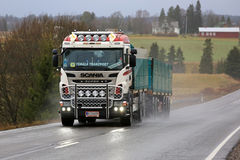 Customized Scania Trucking in Wet Weather Royalty Free Stock Photo