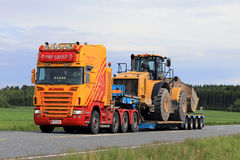 Customized Semi Trailer Hauls Large Wheel Loader Royalty Free Stock Photo