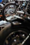 Customs Biker Garage. Row of motorcycles set for repairing in mechanics workshop with back wheels in focus royalty free stock photos