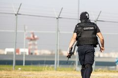 Customs and border protection officer. And Drug enforcement administration special force participates in a training at the airport for searching and seizing of royalty free stock photos