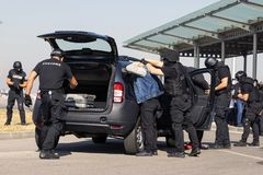 Customs and border protection officers. And Drug enforcement administration special forces participate in a training at the airport for searching and seizing of stock image