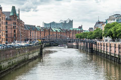 Customs channel in the old warehouse district Speicherstadt in Hamburg, Germany with Elbphilharmonie concert hall in. Background, EUrope Royalty Free Stock Photos