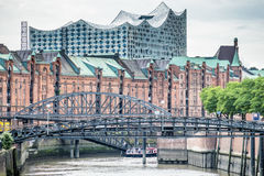 Customs channel in the old warehouse district Speicherstadt in Hamburg, Germany with Elbphilharmonie concert hall in. Background, EUrope Stock Photography
