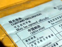 Customs declaration. On a foreign packet parcel Stock Photos