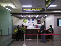 Customs desk in Taipei Songshan Airport. Taipei, Taiwan - JUNE 27, 2015: Customs Information and Foreign Passenger VAT Refund Service Counter in Taipei Songshan Royalty Free Stock Photography
