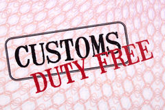 Customs duty free stamps on passport paper closeup Royalty Free Stock Images