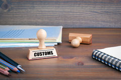 Customs. Rubber Stamp on desk in the Office.  Stock Image