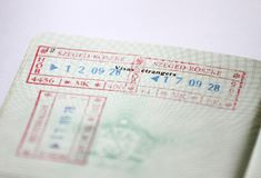 Customs stamps in international passport for traveling around the World. Document for traveling. Stamps and visas. royalty free stock photos