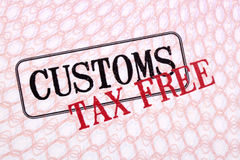 Customs tax duty free stamps on passport page close up Royalty Free Stock Image