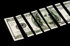 Cut 100 dollar bill Royalty Free Stock Photography