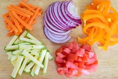 Free Cut And Diced Vegetables On A Wooden Cutting Board. Royalty Free Stock Images - 102765869