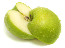 Cut apart fresh green apple Royalty Free Stock Image