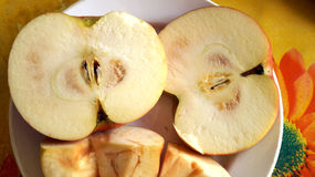 Cut apple with initial signs of rot Royalty Free Stock Images