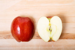 Cut Apple on Wood Cutting Board Royalty Free Stock Photography