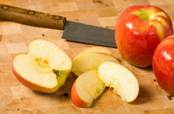 Cut Apples on Cutting Board Royalty Free Stock Photos