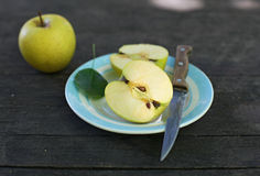 Cut apples on wooden background Stock Image