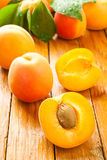 Cut apricot. On a wooden desk Royalty Free Stock Photography