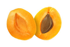 Cut apricot fruits isolated on white. Background Royalty Free Stock Photo