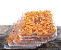 Cut apricots on dehydrator tray,fruit dryer Royalty Free Stock Photos