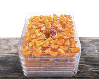 Cut apricots on dehydrator tray,fruit dryer Stock Images