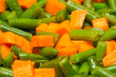 Cut asparagus beans and diced carrot Royalty Free Stock Photos