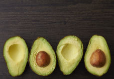 Cut Avocado halves and seeds Stock Photography