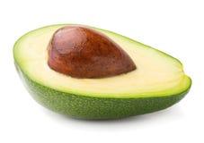 Cut avocado. Single ripe cut avocado on white background stock image