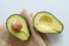 Cut avocado. Two halves of Avocado with a stone Stock Photography