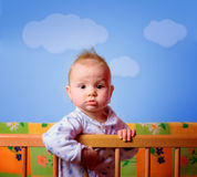 Cut baby girl in her crib Royalty Free Stock Image