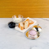 Cut baguette with blue berry cream cheese Royalty Free Stock Image