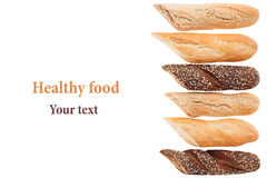 Cut baguette bread of different varieties on a white background. Rye, wheat and whole grain bread. Stock Photos
