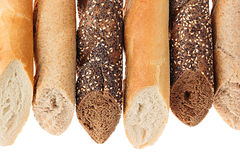 Cut baguette bread of different varieties on a white background. Rye, wheat and whole grain bread. Isolated. Decorative frame of b Royalty Free Stock Photos