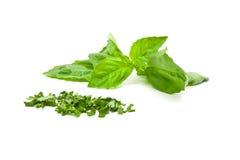 Cut basilicum. Cut and whole basilicum leafes over white background Royalty Free Stock Image
