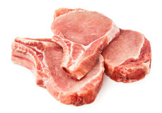 Cut beef fillet on ribs. Against white background stock images