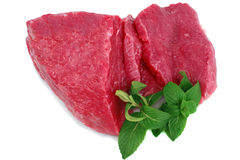Cut of beef steak with green leaf. Isolated stock photos