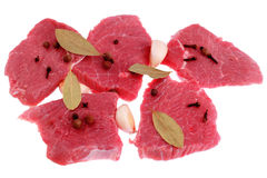 Cut of beef steak with laurel,. Garlic and flavouring. Isolated royalty free stock photo
