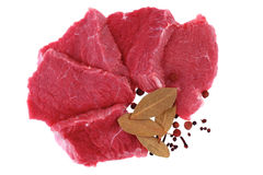 Cut of beef steak with laurel and flavouring. Isolated stock photography