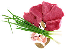 Cut of beef steak with laurel, onion, garlic. And flavouring. Isolated stock photos