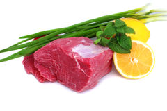 Cut of beef steak with lemon slice and onion. Isolated royalty free stock photos