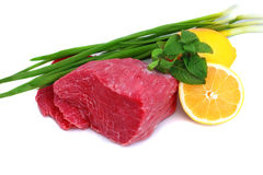 Cut of beef steak with lemon slice and onion. Isolated royalty free stock photography