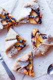 Cut biscuits with peach and blueberry. Top view Royalty Free Stock Image